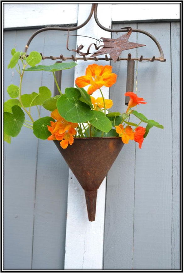 An Old Hanging Flower Holder Garden Decoration Ideas Home Decor Ideas