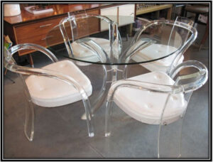 Furnish using Lucite tables and chairs